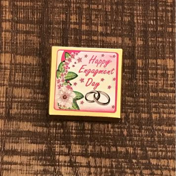 "Picture of ""Happy Engagment Day"" Label Over Chocolate Piece"