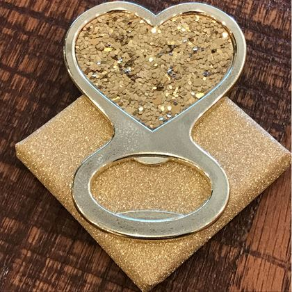 Picture of Gold Glitter Heart Bottle Opener Over  Wrapped Chocolate Piece